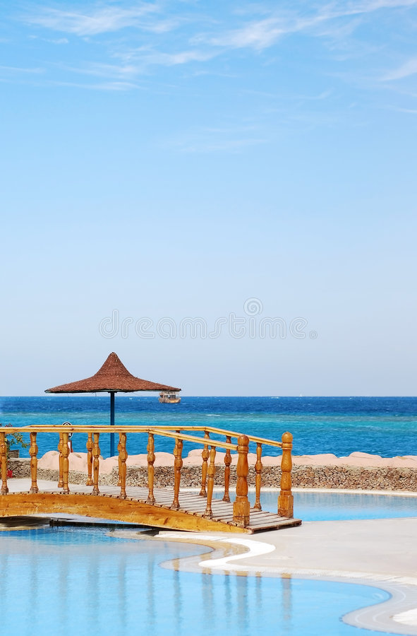 Swimming pool and the sea royalty free stock photo