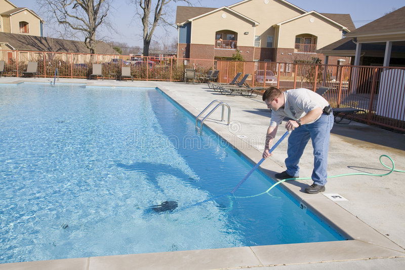 Swimming Pool Maintenance Services : Swimming pool service stock image of work