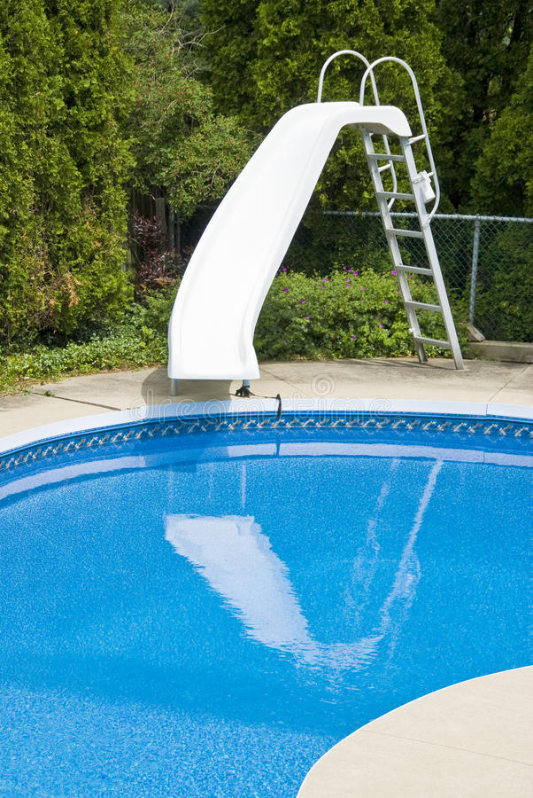 Swimming Pool with a Slide royalty free stock photography