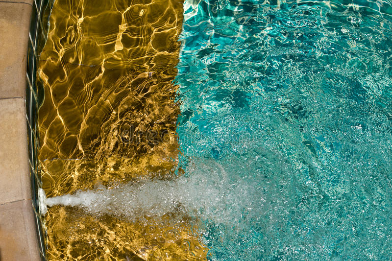 Swimming pool with sunny reflections stock images