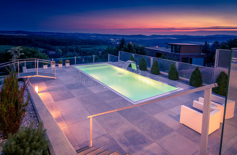 Swimming pool at sunset, Czech Republic royalty free stock images