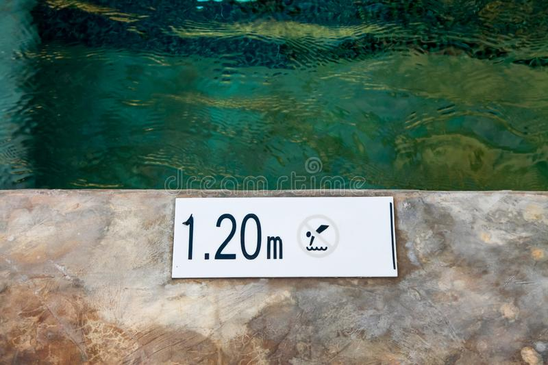 Swimming pool. Abstract, background, beautiful, blue, bottom, bright, clean, clear, design, floor, holiday, liquid, mosaic, pattern, refreshing, ripple, summer stock photo