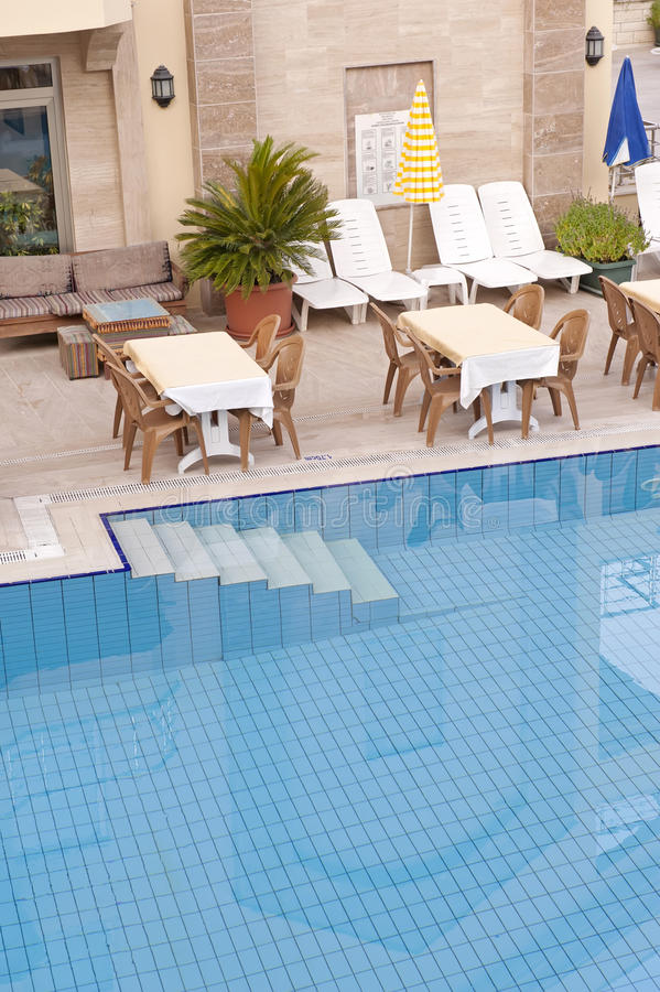 Download Swimming pool and tables stock photo. Image of holiday - 26464598