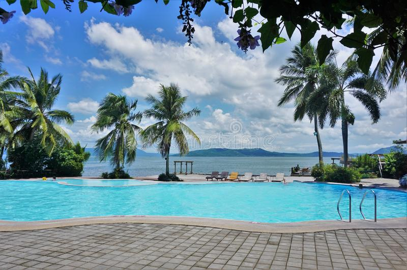Swimming Pool in Tropical Lakeside Waterfront royalty free stock photography