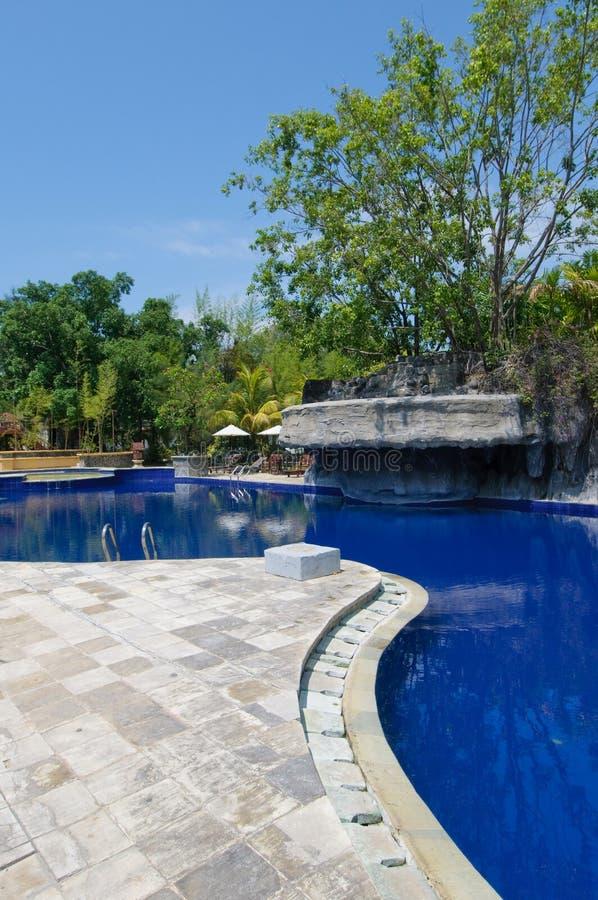 Swimming Pool At Tropical Resort Stock Photo