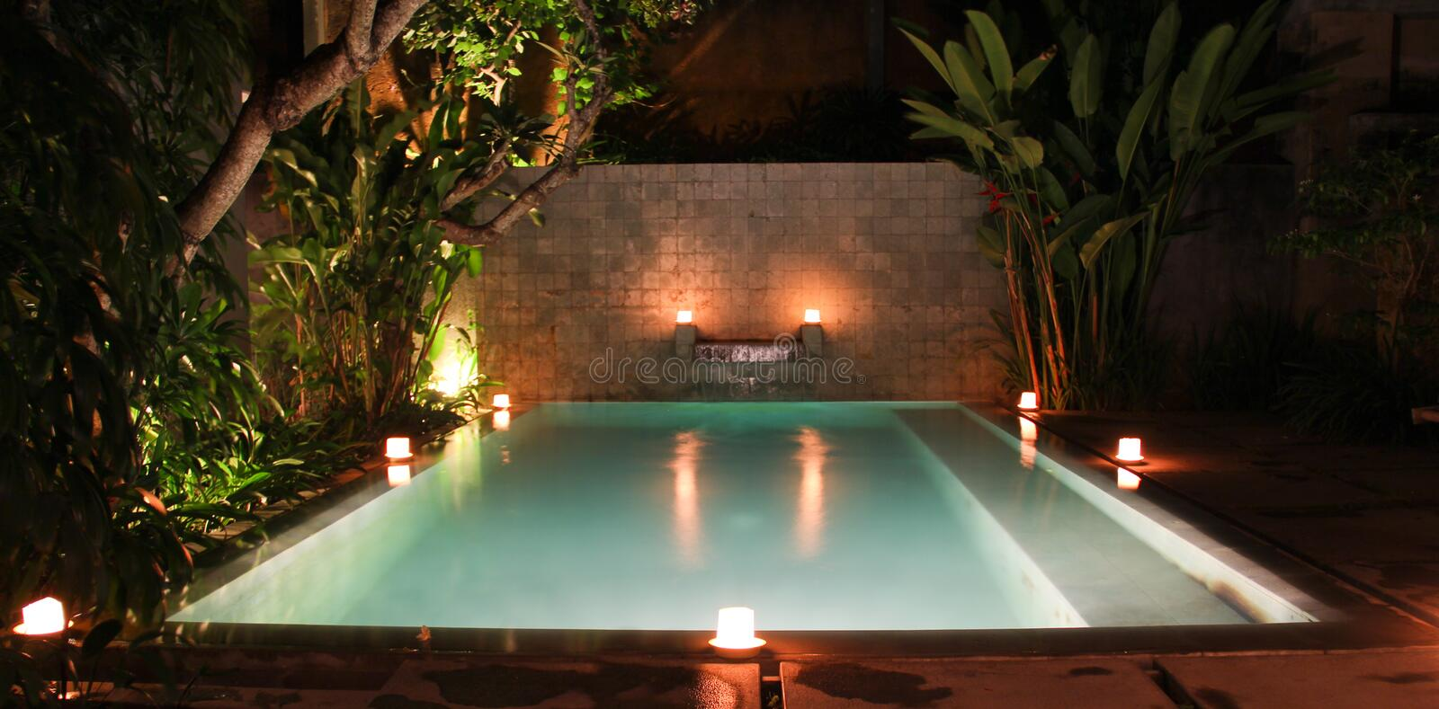 SWIMMING POOL ON VILLA WITH CANDLELIGHT stock photos
