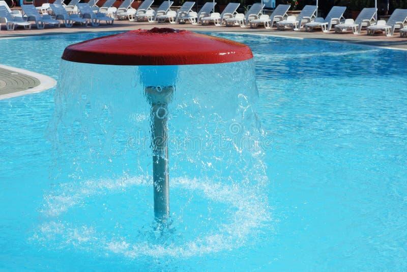 Swimming pool water fountain mushroom umbrella stock image - Waterford crystal swimming pool times ...