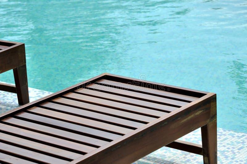 Swimming Pool Wooden Longue Stock Photo