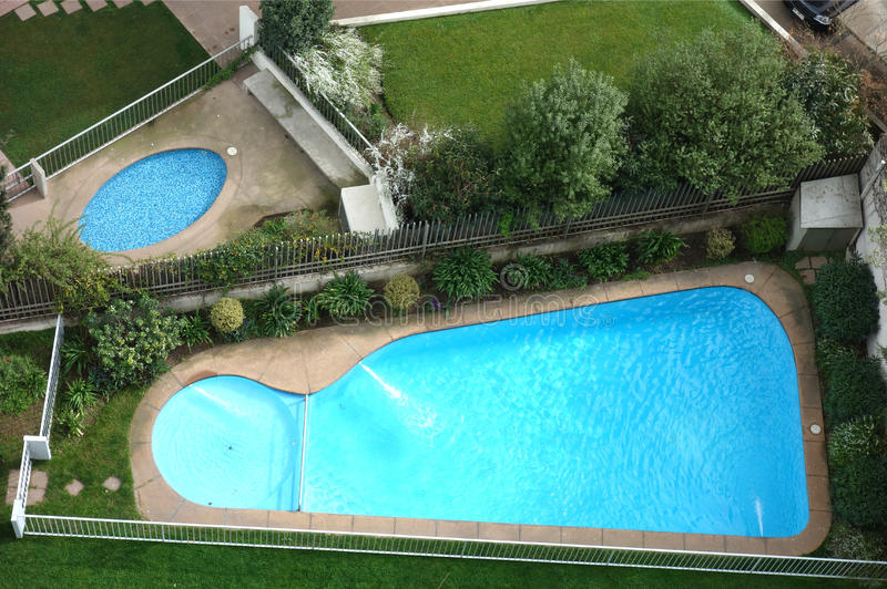 Swimming Pools. Two swimming pools, seen from above royalty free stock photo
