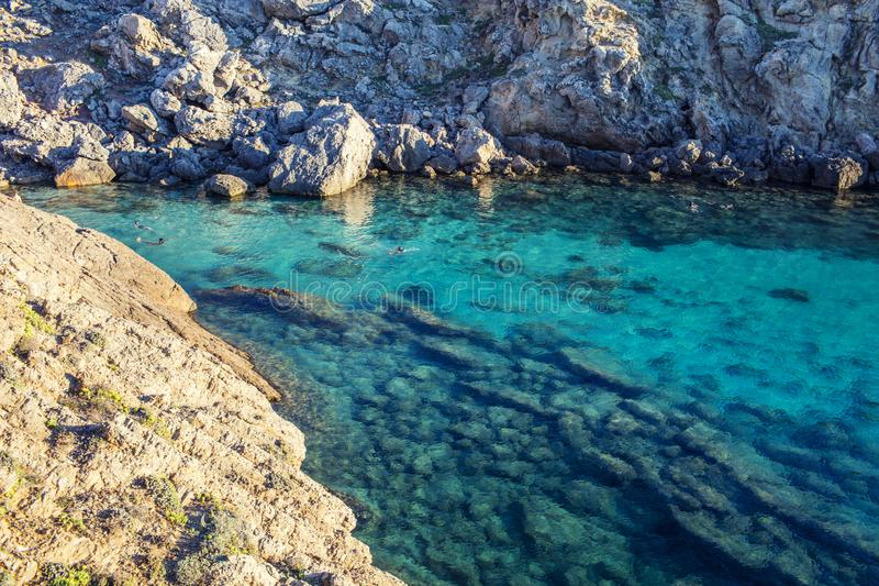 Swimming in rock lagoon royalty free stock images