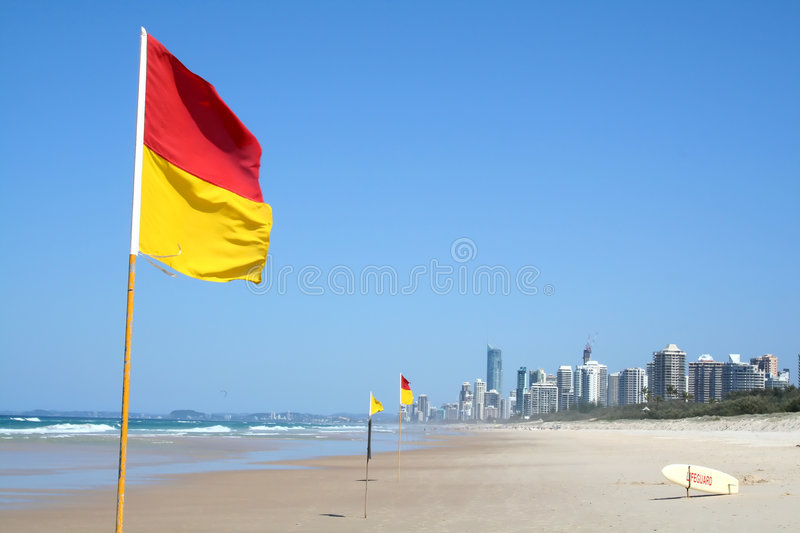 Swimming Safety Flags Gold Coast. Swimming safety flags on the Gold Coast Northern beach looking towards Surfers Paradise royalty free stock image