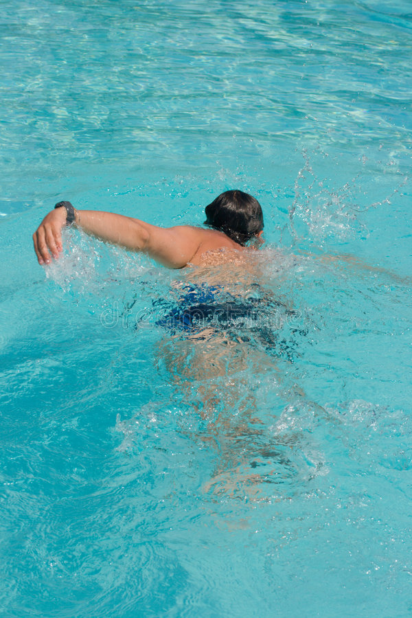 Swimming young man stock images