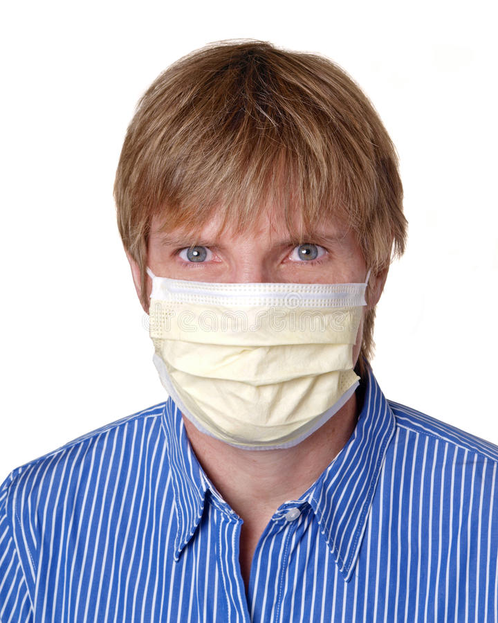Swine flu protection. Yellow surgical mask protecting against cold and flu viru royalty free stock images