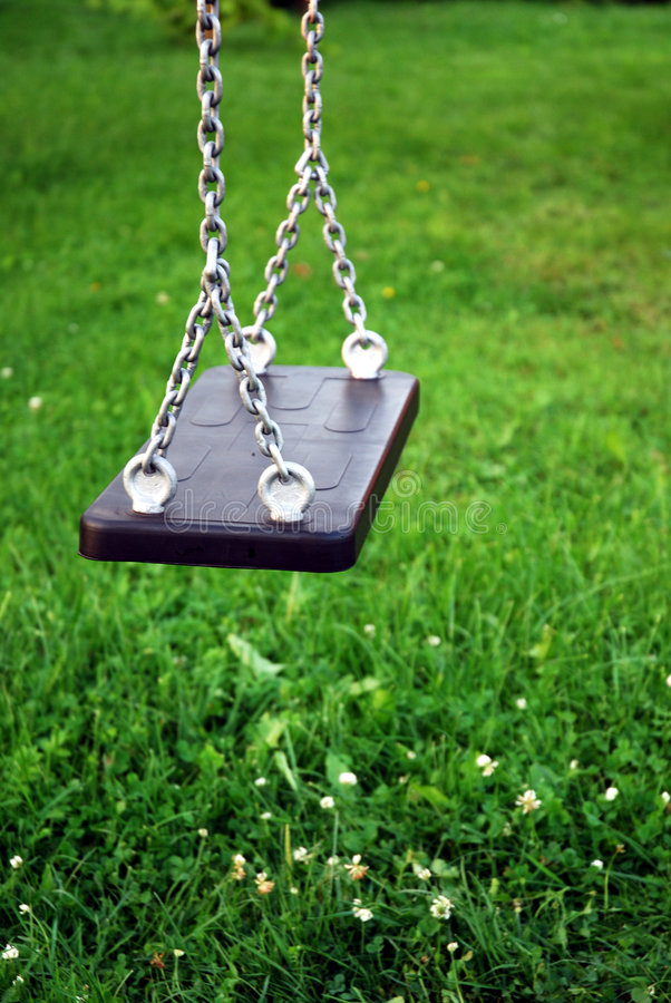 Swing 2. Close-up of empty swing in the garden stock photo