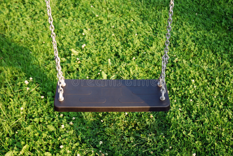 Swing 3. Close-up of empty hanging swing in the garden royalty free stock photography