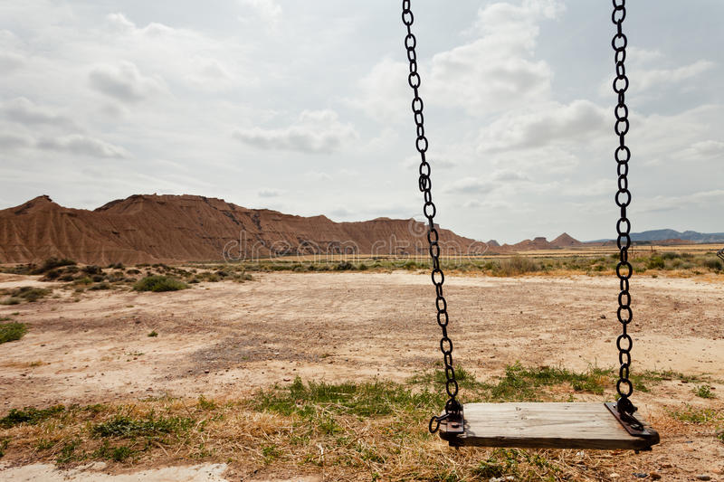 Swing in Bardenas Reales, Navarra, Spain. The Bárdenas Reales is a semi-desert natural region, or badlands, of some 42,000 hectares (100,000 acres) in stock photography
