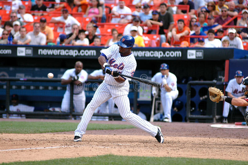 Swing Batter!. New York Mets Shortstop Jose Reyes takes a swing at a pitch stock photos