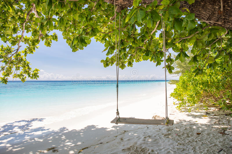 Swing on beautiful crystal clear sea and white sand beach at Tachai island, Andaman. Thailand royalty free stock photography