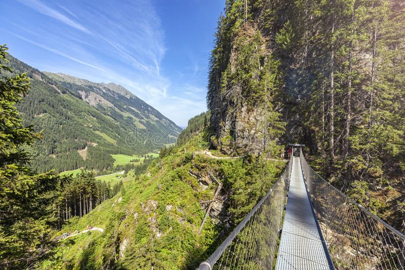 Swing bridge over the Riesach waterfall at Rohrmoos Untertal stock photography
