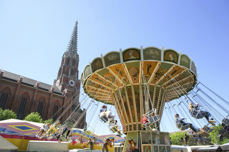Swing Carousel at the Auer Dult Traditional Market in Munich. Chair-O-Plane in Front of Mariahilf Church at the Auer Dult, traditional market in Munich, Bavaria stock photos