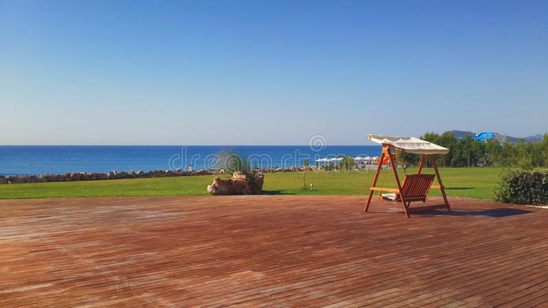 Swing chairs in luxury resort stock photos