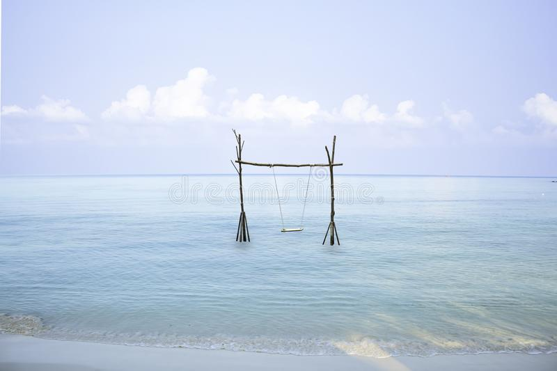 Swing chairs made from wood in the sea Background sky and cloud stock photography