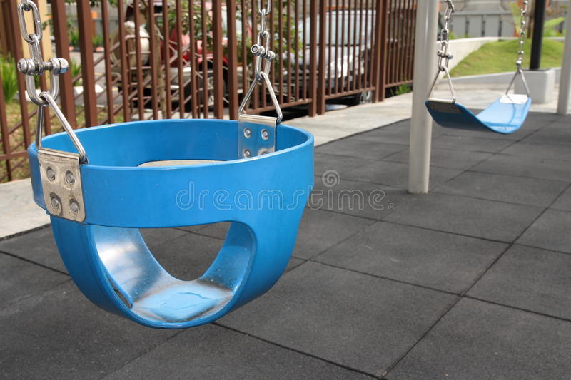 Swing On The Children S Playground Royalty Free Stock Photos