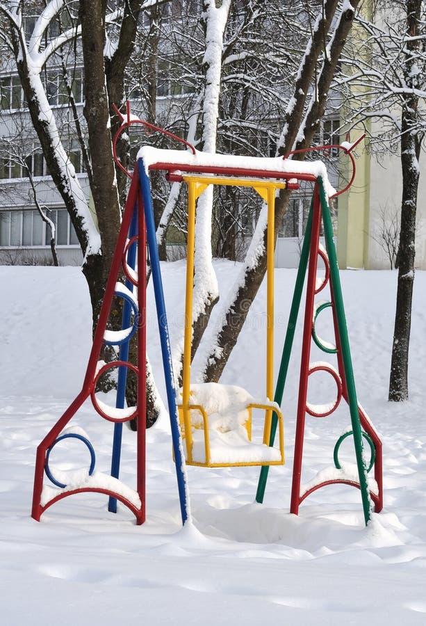 Swing for children in winter stock image