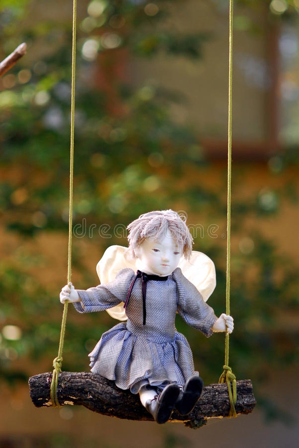 Swing doll stock photography