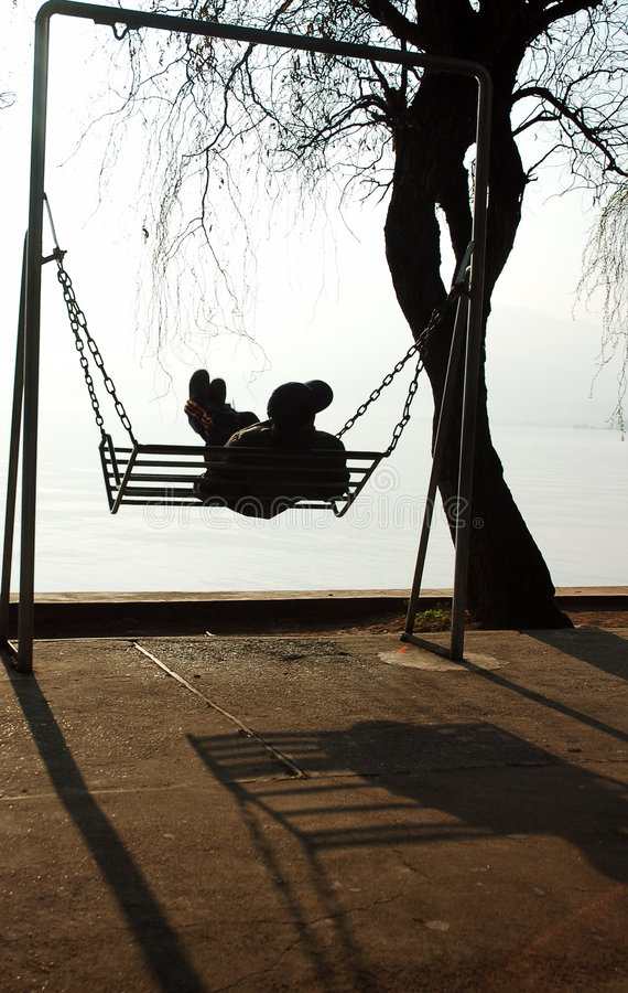 Swing by a lake royalty free stock photos