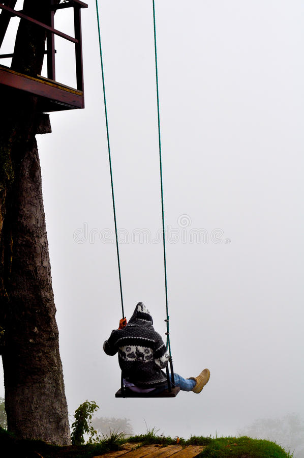 Swing over the abyss in Ecuador stock image