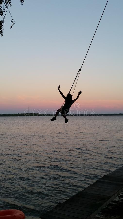 Swing over the Water. royalty free stock photos