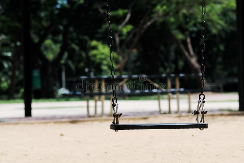 A swing in the public Playground stock photos