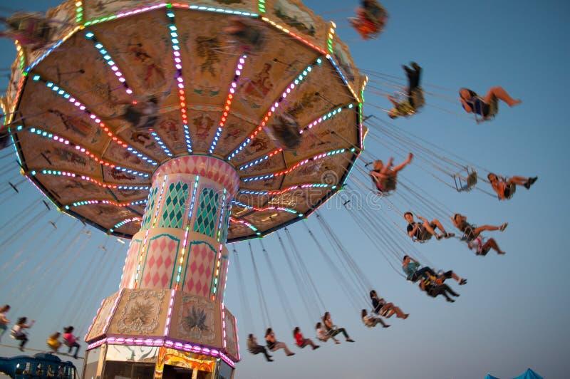 Swing ride at fair. Swing ride at county fair at dusk royalty free stock photography