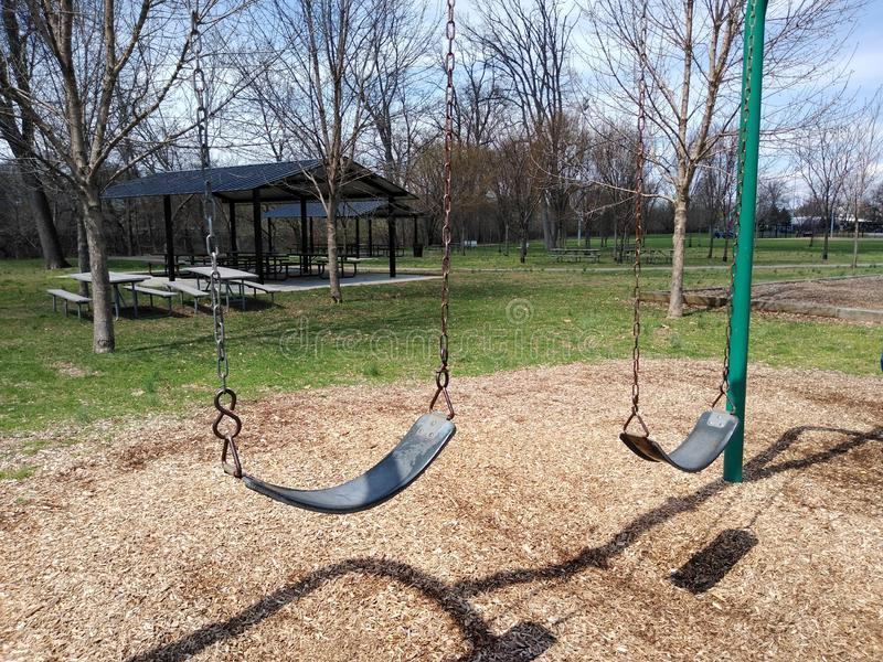 Swing Set in a Playground stock photo