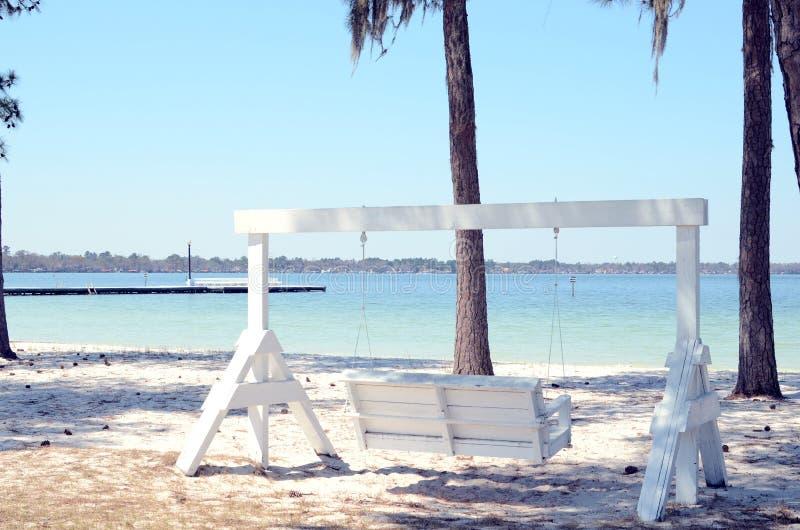 Swing next to the Lake royalty free stock image