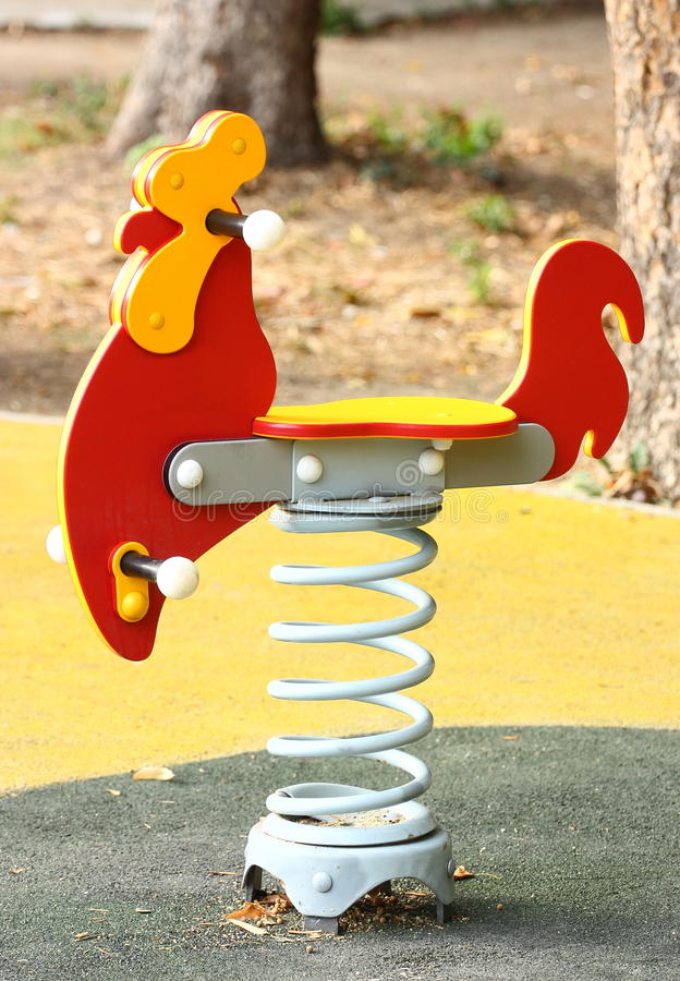 Swing spring. Rooster swing spring outdoor on a playground royalty free stock images