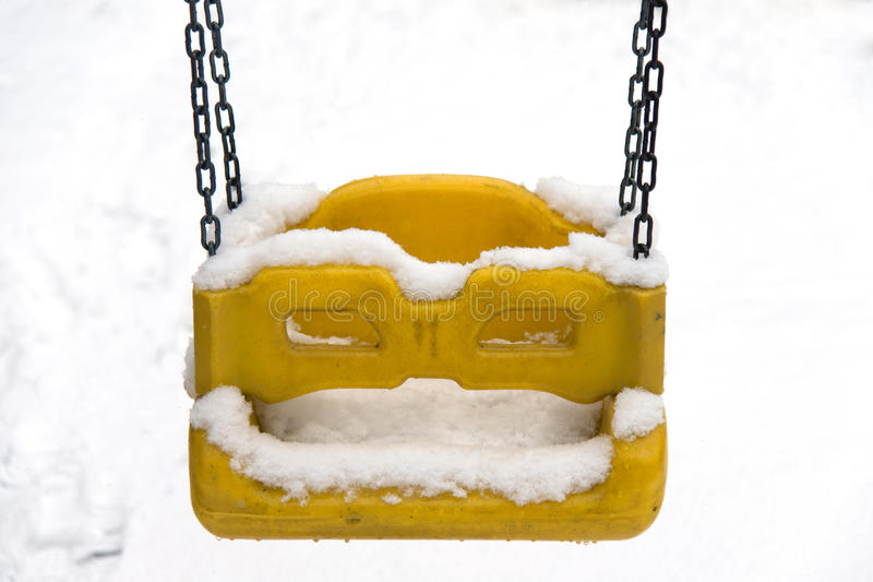 Swing under snow stock photography
