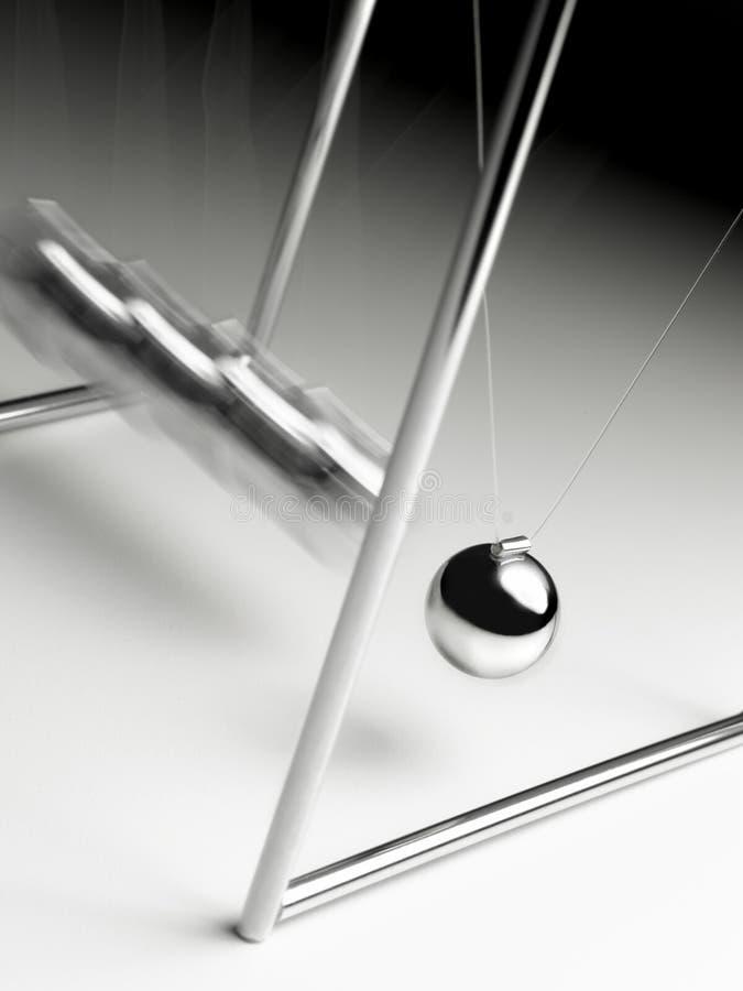 Swinging ball desk toy stock photo