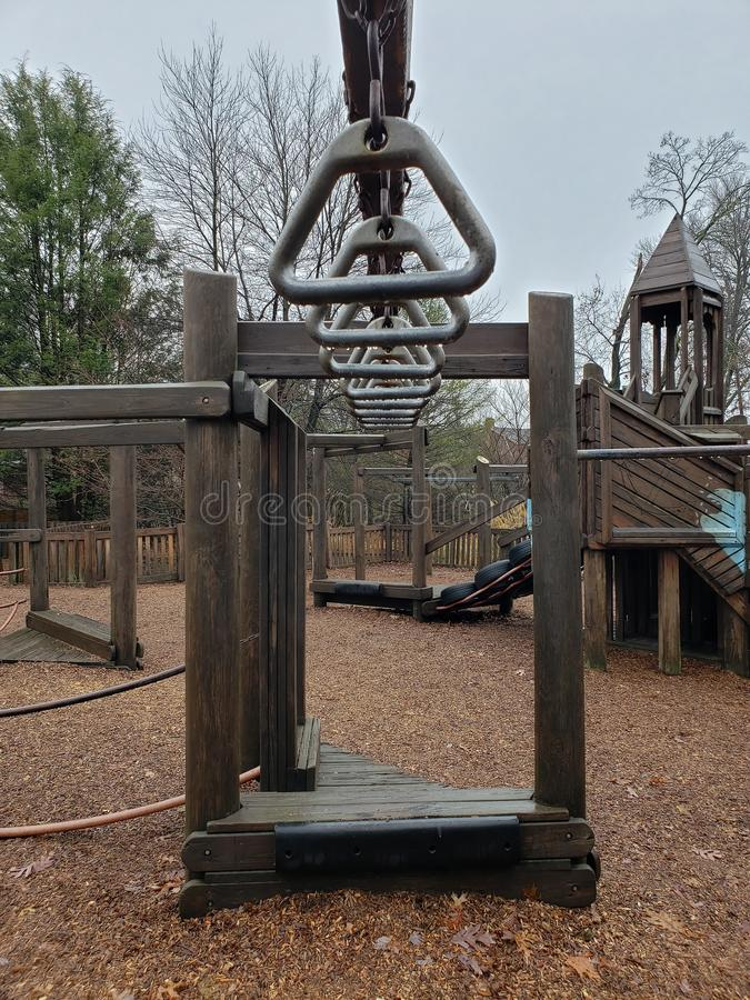 Swinging bars on a play set high off the ground stock images