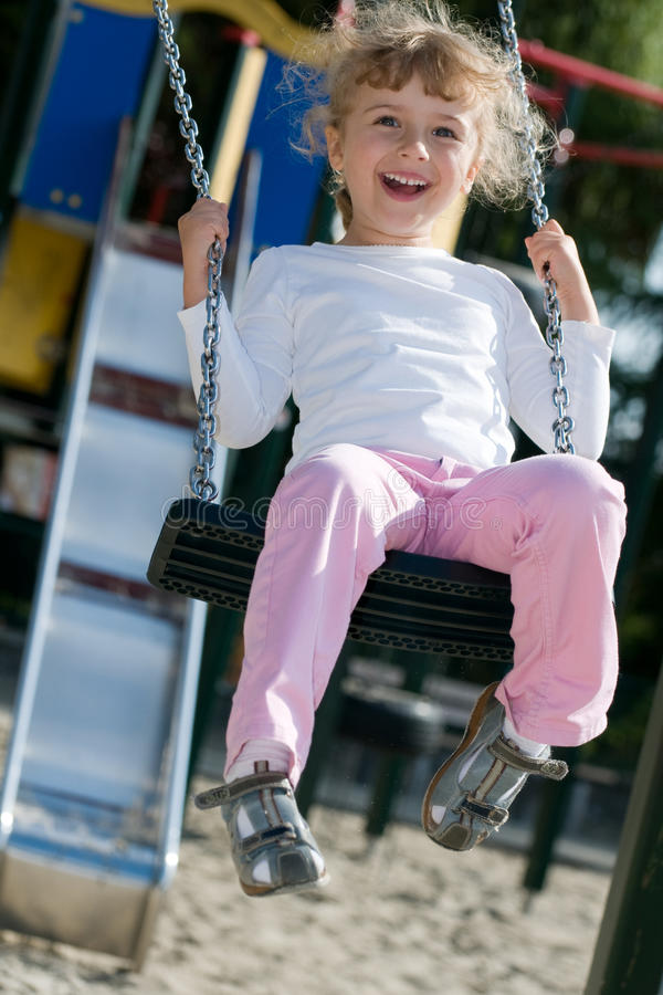 Download Swinging girl stock photo. Image of people, playground - 14850072