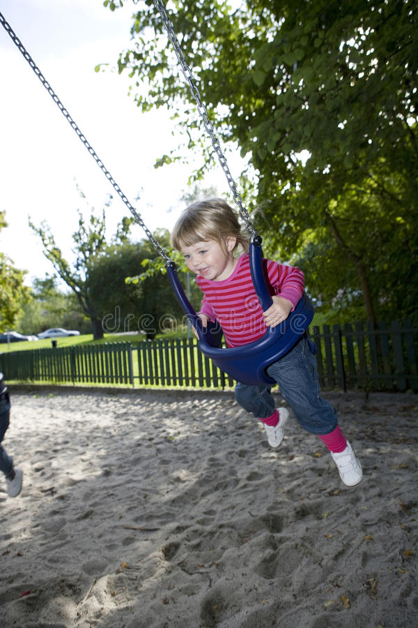 Swinging Girl royalty free stock image