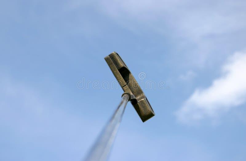 Swinging golf club and sky stock photos