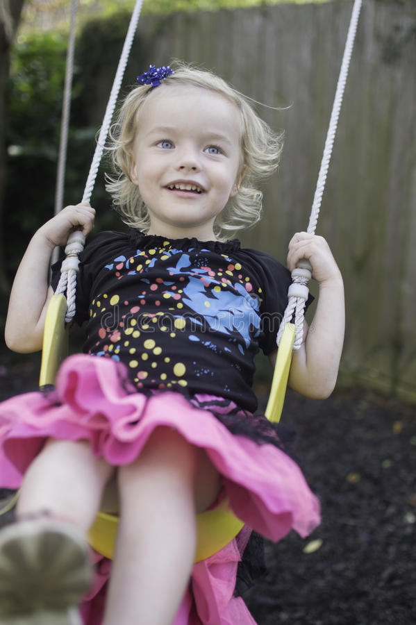 Swinging and Smiling stock photos