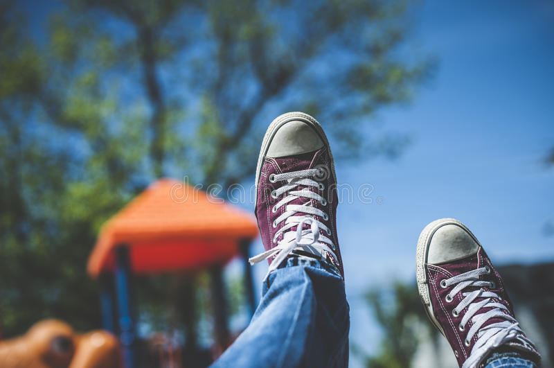 Download Swinging throught the sky stock image. Image of jeans - 59059545