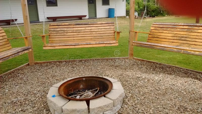 Swings and fire pit. royalty free stock image