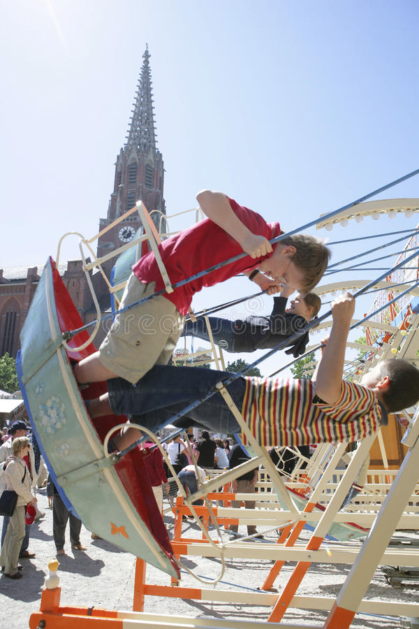 Swings at the flea market Auer Dult in Munich. Swings at the flea market Auer Dult, Munich, Upper Bavaria, Bavaria, Germany stock photos