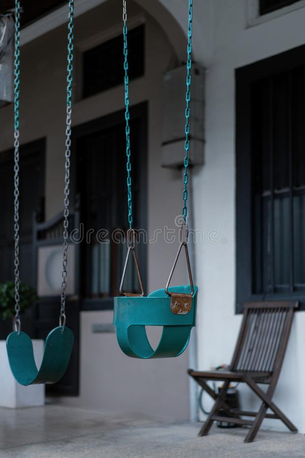 Swings hung in front of heritage home in singapore at emerald hill stock image
