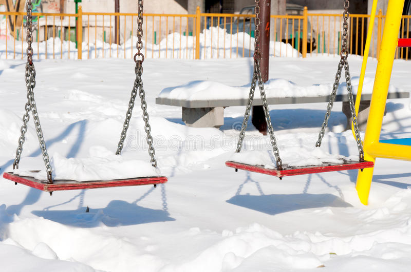 Swings at winter royalty free stock images