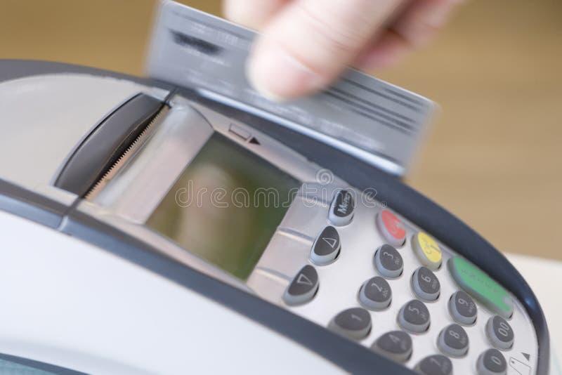 Swiping Credit Card stock image